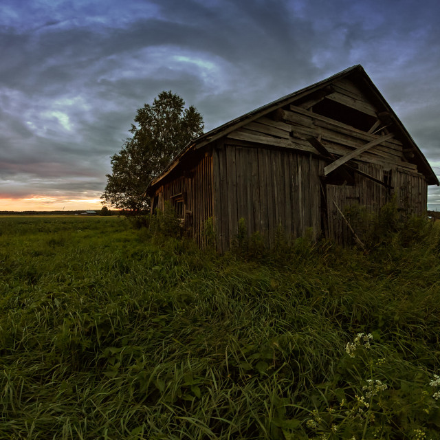 """""""Round Clouds Over An Old Barn House"""" stock image"""