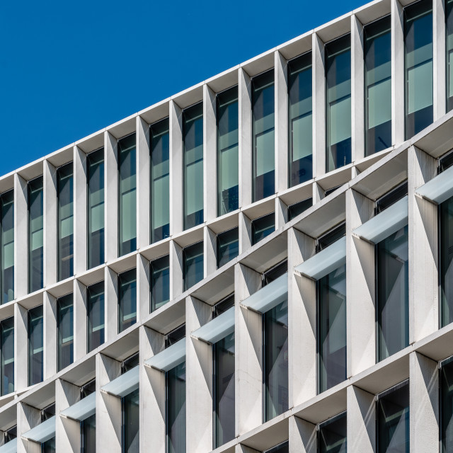 """Low angle view of the facade of modern office building"" stock image"