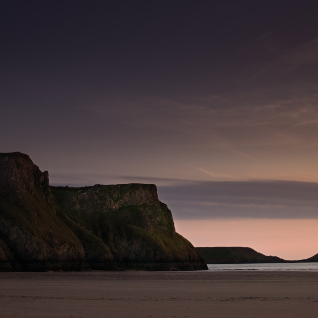 """The Worms Head and Cliffs of Rhosilli Bay, The Gower."" stock image"