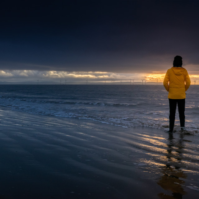 """Anonymous at gazing out to sea, Formby"" stock image"