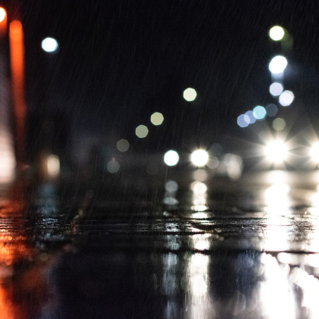 """Street level side-street on a rainy night in Manchester"" stock image"