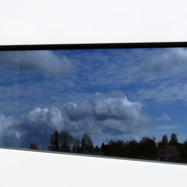 """Reflection of sky and buildings in Umea, Sweden through window"" stock image"