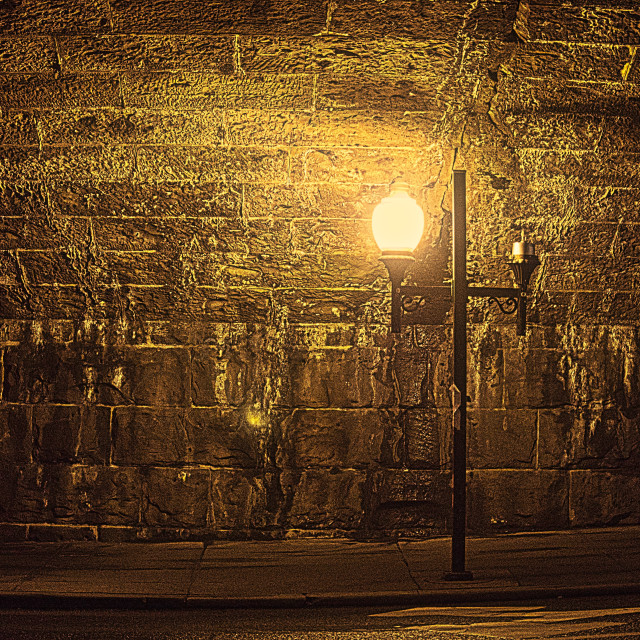 """Night in the City - Lamppost and Stone wall"" stock image"