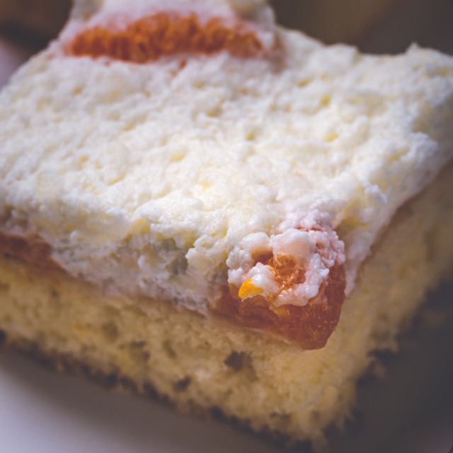 """""""Few pieces of cake with cream topping with pieces of tangerines"""" stock image"""
