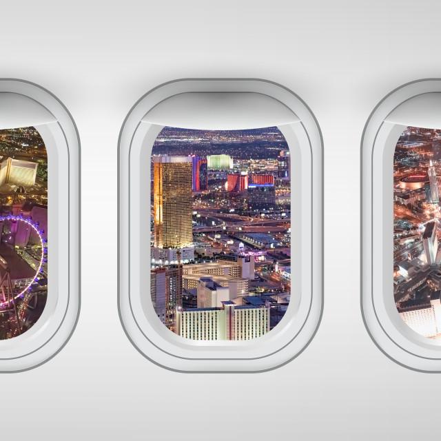 """Las Vegas night aerial skyline as seen through five aircraft windows. Holiday..."" stock image"