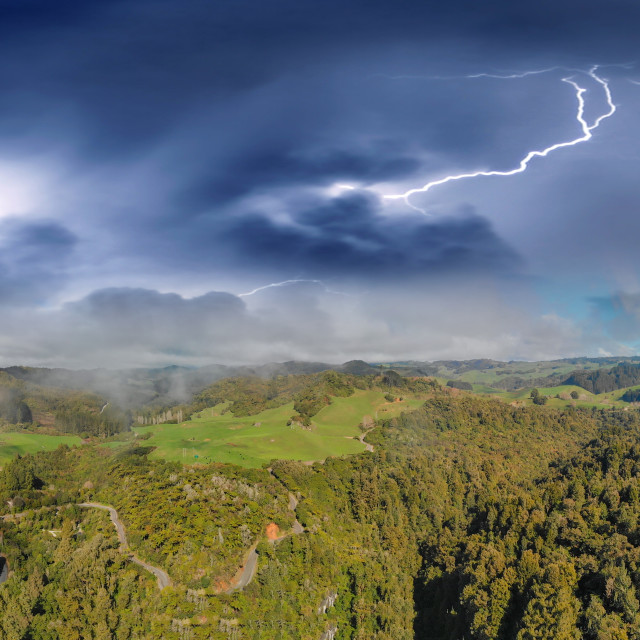 """""""Storm over Waitomo countryside in New Zealand, aerial view"""" stock image"""