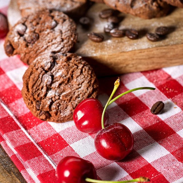 """Oatmeal chocolate cookies with coffee grains and cherry. Sun flare"" stock image"