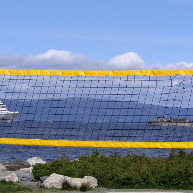 """Cruise ship entering Trondheim seen through volleyball net"" stock image"