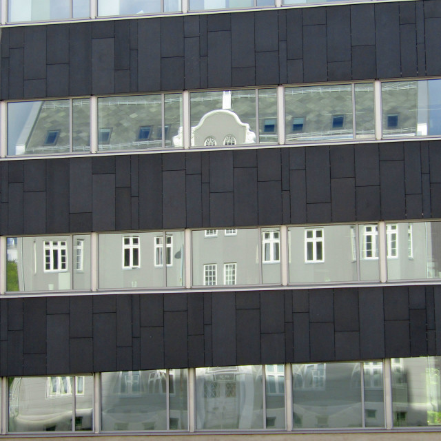 """Reflection of old building in new building across the street in Trondheim"" stock image"