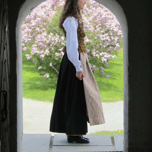 """Girl in Trondheim traditional confirmation dress at Kristiansen Fort"" stock image"