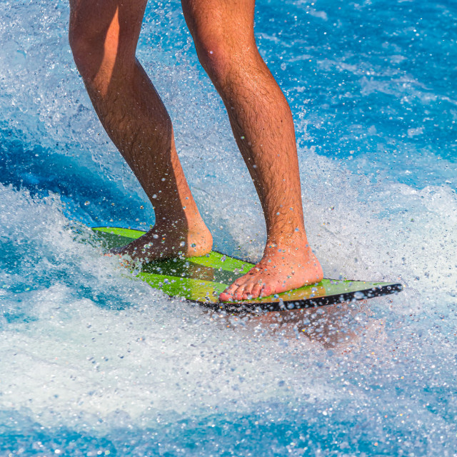 """""""Surfer on Green Board"""" stock image"""