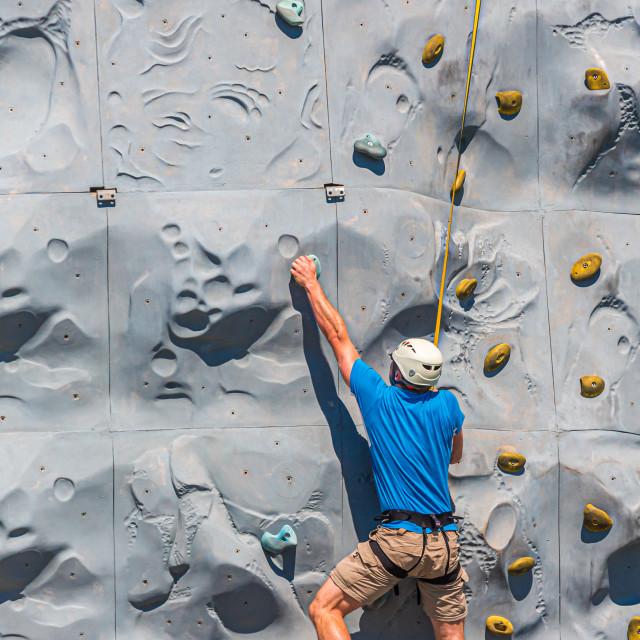 """Rock Climber in Blue Shirt"" stock image"