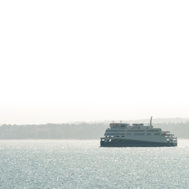 """passenger ferry on a hazy coastline"" stock image"