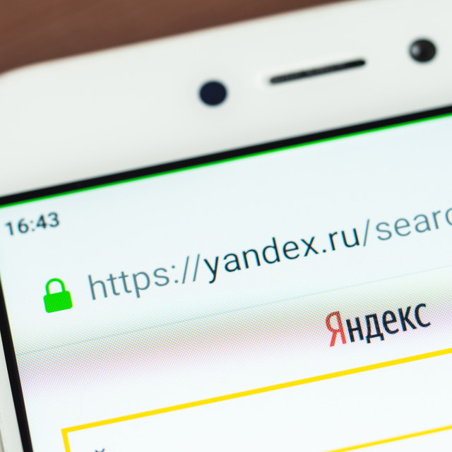 """Yandex logo on smartphone screen"" stock image"