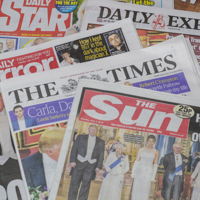 """Pile of English Newspapers from the United Kingdom"" stock image"