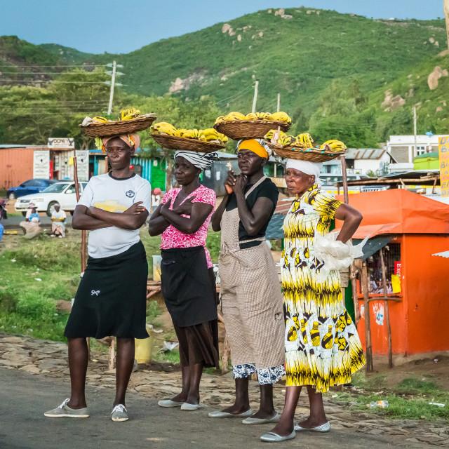 """""""Kisumu, Kenya - March 8, 2019 - women sell bananas on a roadside"""" stock image"""