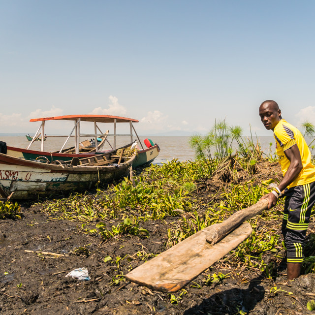 """near Kisumu, Kenya - March 8, 2019 - fishermen on the coast of lake Victoria"" stock image"