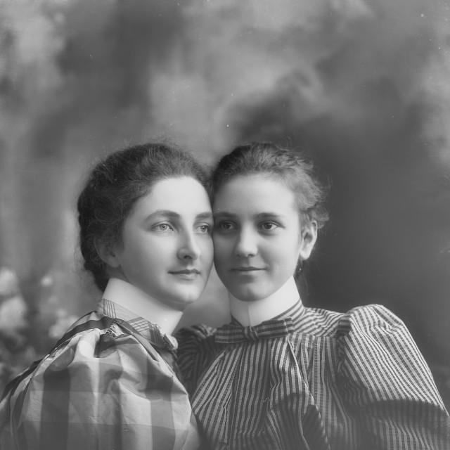 """Antique Portrait of Two Women in elegant dresses"" stock image"