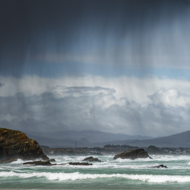 """Rain showers blown by the wind between the sea and the cliffs"" stock image"