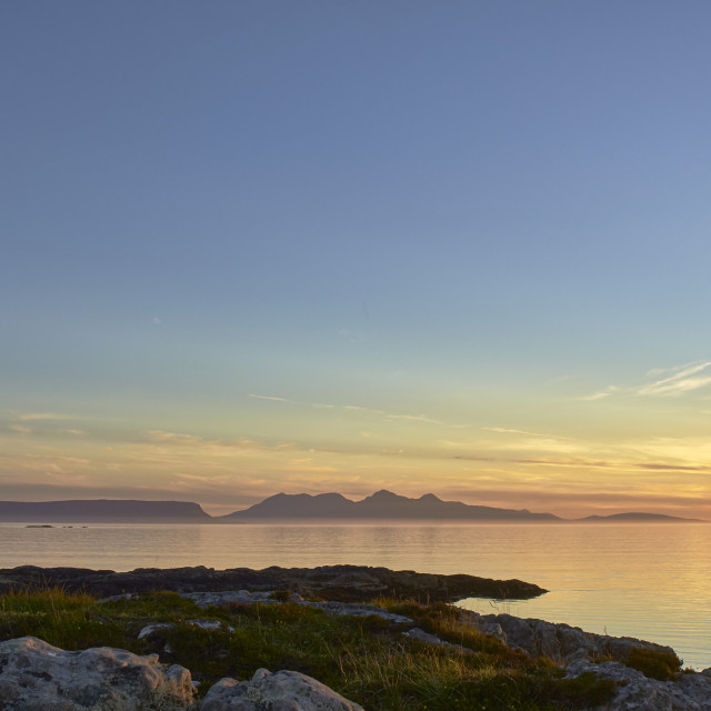 """Sunset over Eigg and Rum of the west coast of Scotland"" stock image"