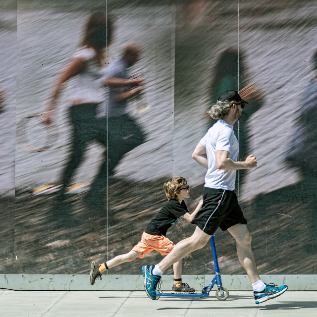 """""""Running and scootering"""" stock image"""