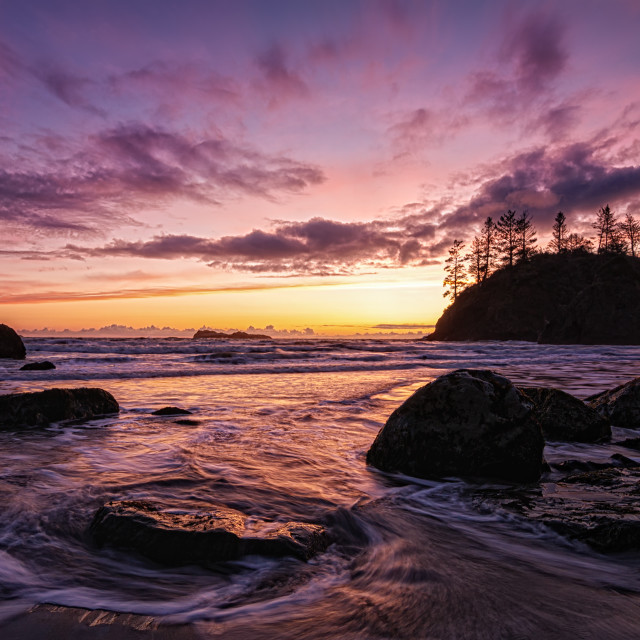 """""""A Dramatic Sunset at the Beach, Color Image"""" stock image"""