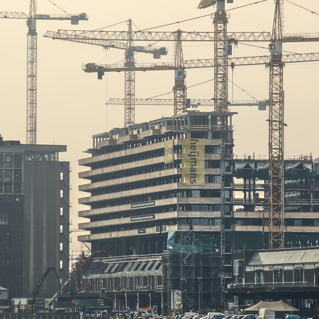 """Tower cranes at Rotterdam waterfront"" stock image"