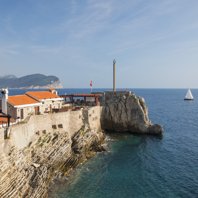 """""""View along cliffs to 16th century Venetian fortress overlooking the Adriatic..."""" stock image"""