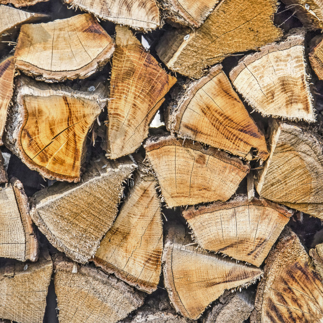 """""""Stack of logs at a fireplace"""" stock image"""