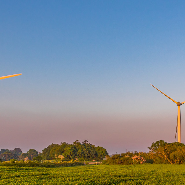 """Three Wind Turbines at Sunset"" stock image"