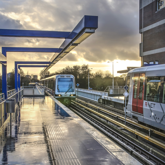 """""""Metro trains under a dramatic sky"""" stock image"""