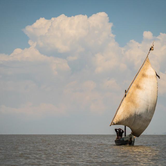 """Dunga fishing village near Kisumu, Kenya - March 8, 2019 - fisherman sailng boat on lake Victoria"" stock image"