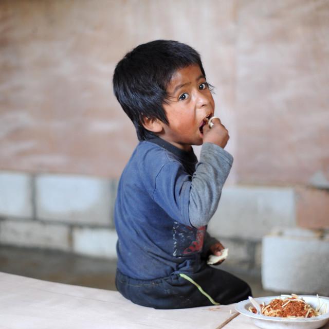 """Maya indigenous boy in Aqua Escondida, Solola, Guatemala."" stock image"