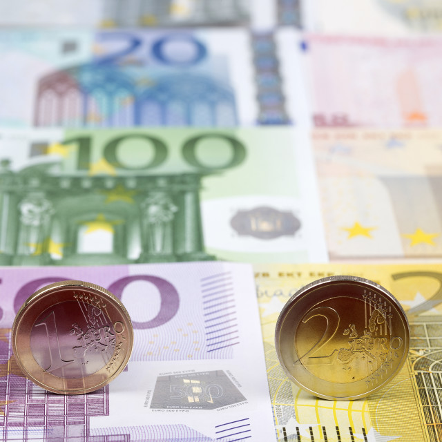 """Euro coins on the background of banknotes"" stock image"