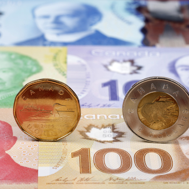 """Canadian Dollar coins on the background of banknotes"" stock image"