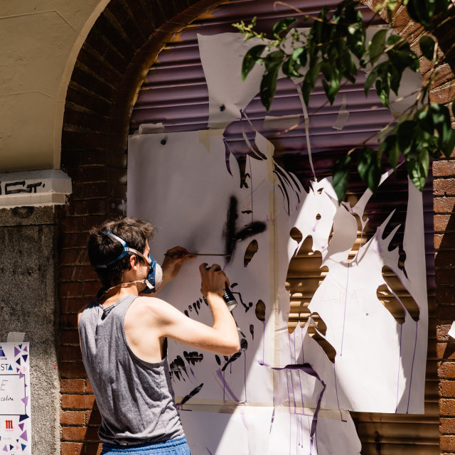 """""""Artist painting storefront in Malasana district in Madrid"""" stock image"""