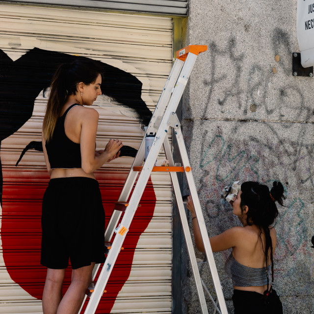"""""""Artists painting storefront in Malasana district in Madrid"""" stock image"""