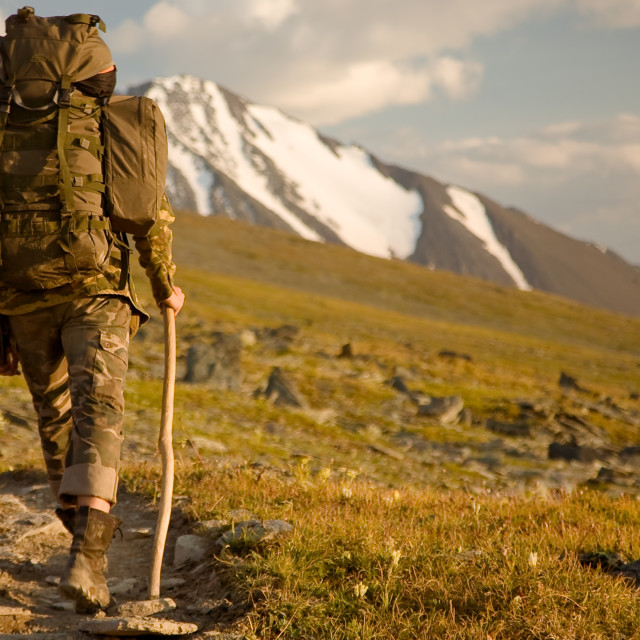 """""""Hiker with a backpack standing in mountains. Amazing nature landscape. Soft light effect"""" stock image"""