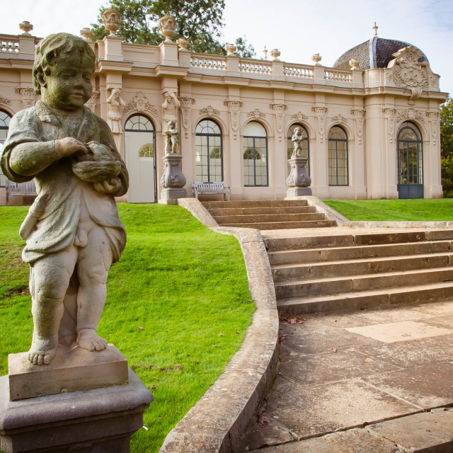 """""""October 2015 - a statue of a boy and pavillion in Wrest park, a country estate located in Silsoe, Bedfordshire, England; its architecture follows the style of an 18th-century French chateau"""" stock image"""