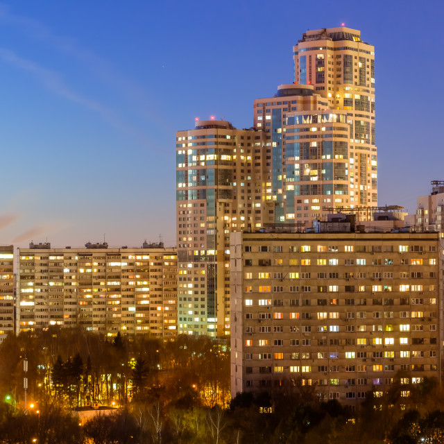 """""""October 2017, Moscow, Russia - night aerial view of modern high rise residential buildings surrounded by autumn pak"""" stock image"""