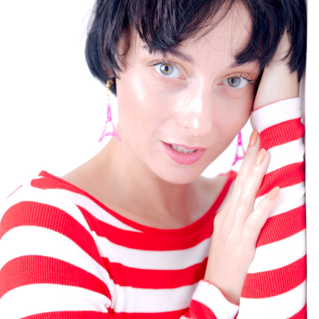 """High Key girl with black hair and french themed clothing"" stock image"