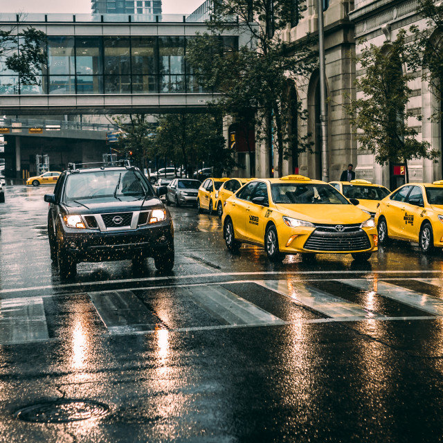 """Yellow cabs in the rain"" stock image"