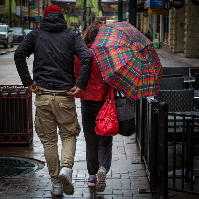 """People with an umbrella walking in the rain"" stock image"