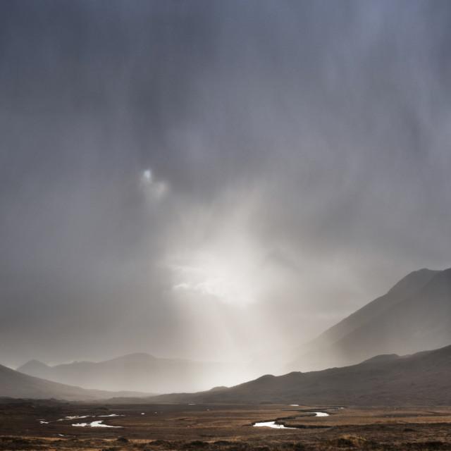 """Sun breaking through the rain"" stock image"