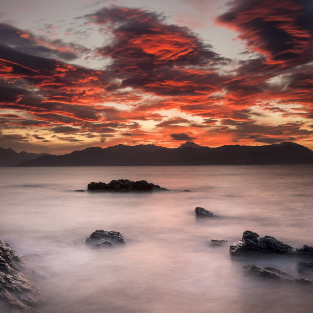"""Sunrise, over sea and mountains"" stock image"