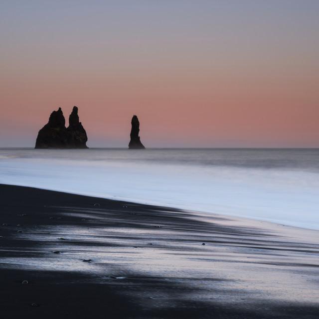 """""""Reynisdrangar sea stacks, pink sunset"""" stock image"""