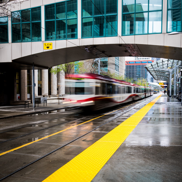 """Speeding train passes through a station"" stock image"