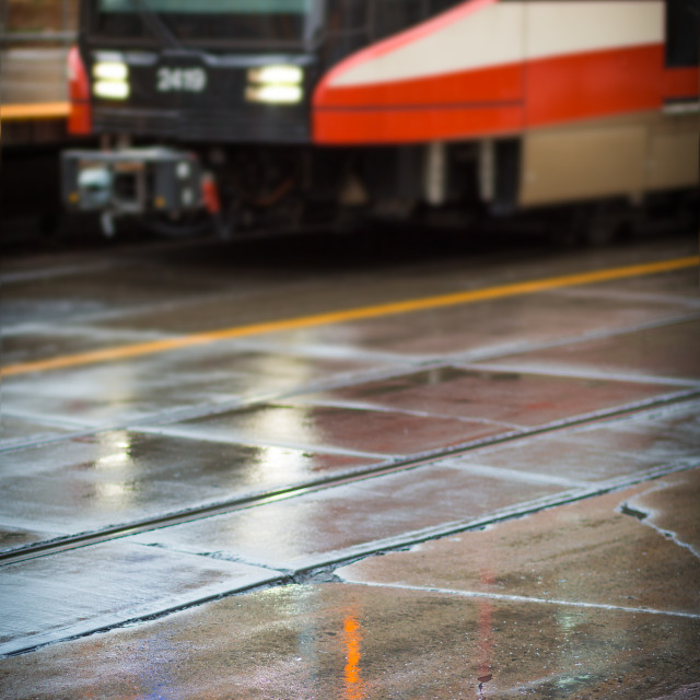 """Train standing at a platform in the rain"" stock image"