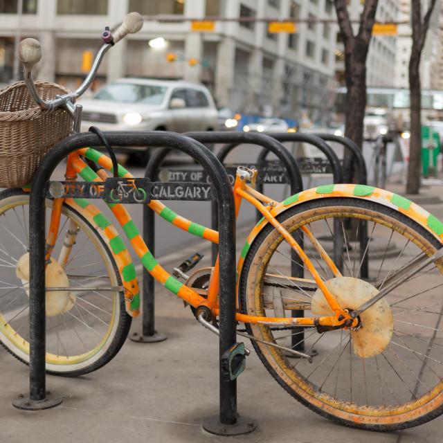 """Vintage cycle on a bike rack"" stock image"
