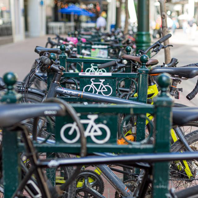 """""""A row of bike in a bike rack"""" stock image"""